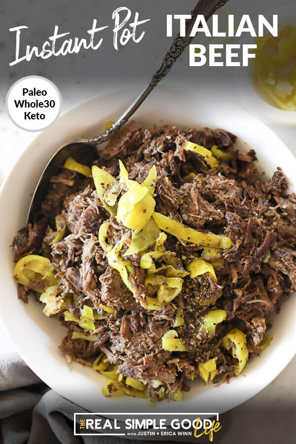Instant pot italian beef shredded in a bowl with peppers and spoon vertical overhead image with text at top
