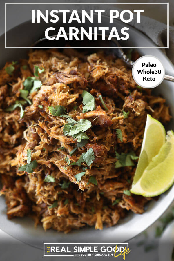 Instant pot carnitas in bowl with lime wedges and cilantro overhead vertical close up image with text at top