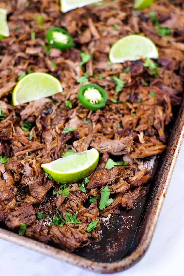 Close up angle shot of Instant pot carnitas on a sheet pan