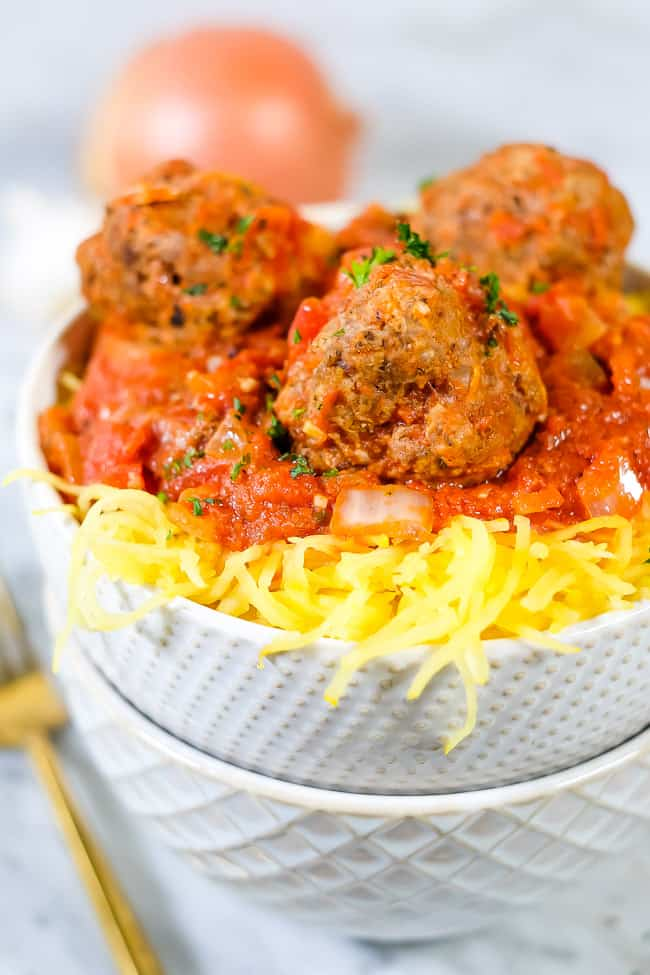 Instant Pot spaghetti and meatballs with parsley sprinkled on top.