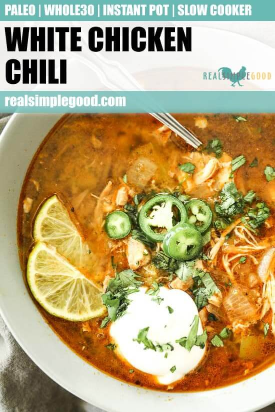 Instant pot white chicken chili vertical image with one bowl close up with toppings and spoon sticking out. Text at top of image for pinterest
