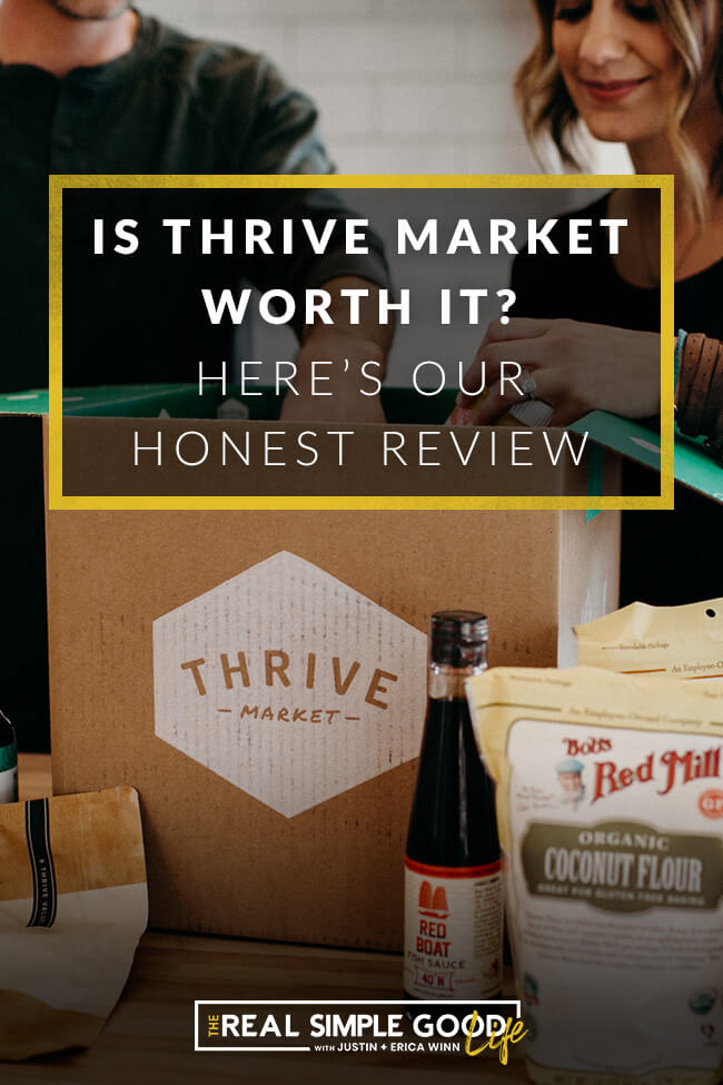Justin and Erica Winn in the kitchen sticking hands in a Thrive Market box