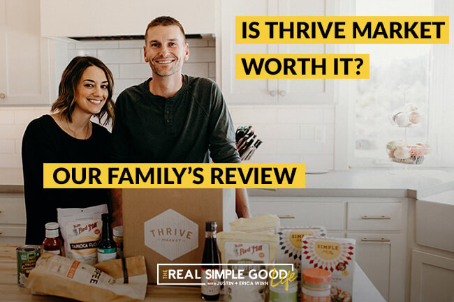 Justin and Erica Winn in the kitchen with Thrive market box and food products on the counter