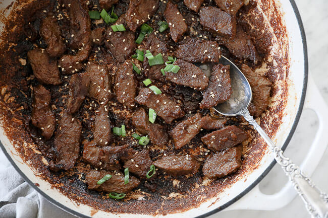Korean beef bulgogi in pan with spoon horizontal image