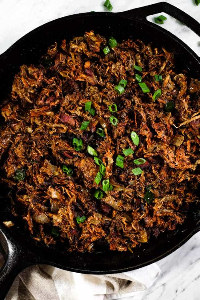 Leftover pulled pork hash in black skillet
