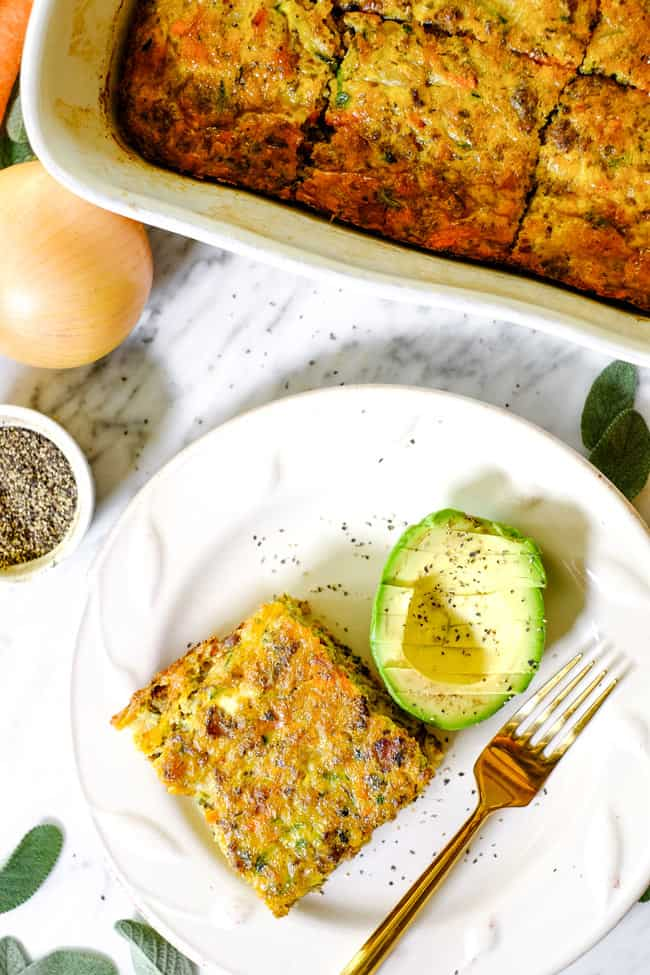Loaded whole30 breakfast casserole overhead with piece on plate with avocado and fork