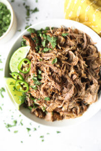 Close up overhead image of mojo pulled pork in a bowl