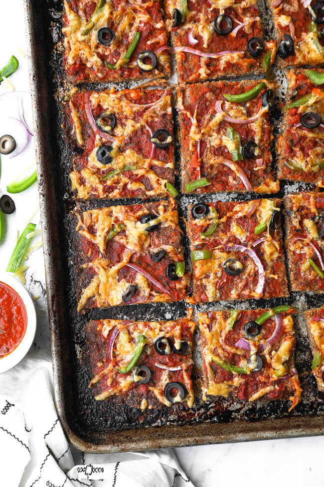 Overhead image of low carb pizza (meatza) on a sheet pan.