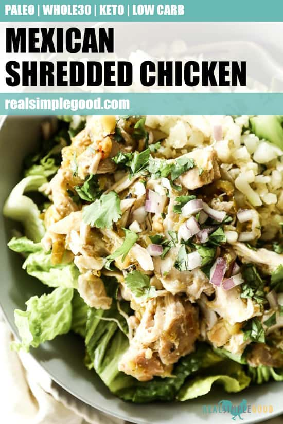 Close up of Mexican shredded chicken in a bowl with romaine lettuce, cauliflower rice and avocado. Topped chopped red onion and cilantro. Text overlay at top of image for pinterest.