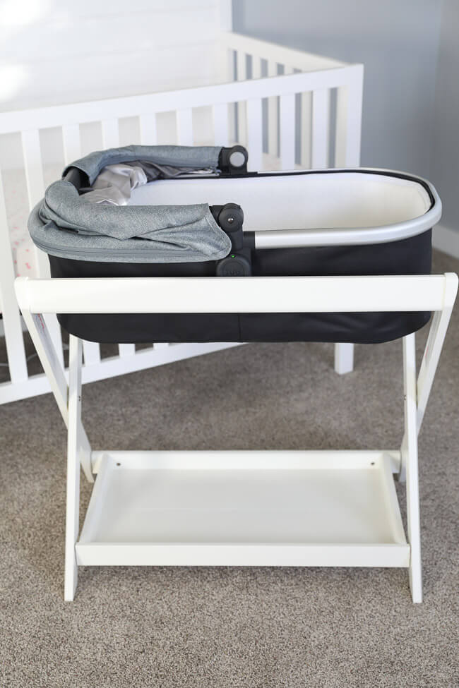 Vertical image of bassinet for baby to sleep in.