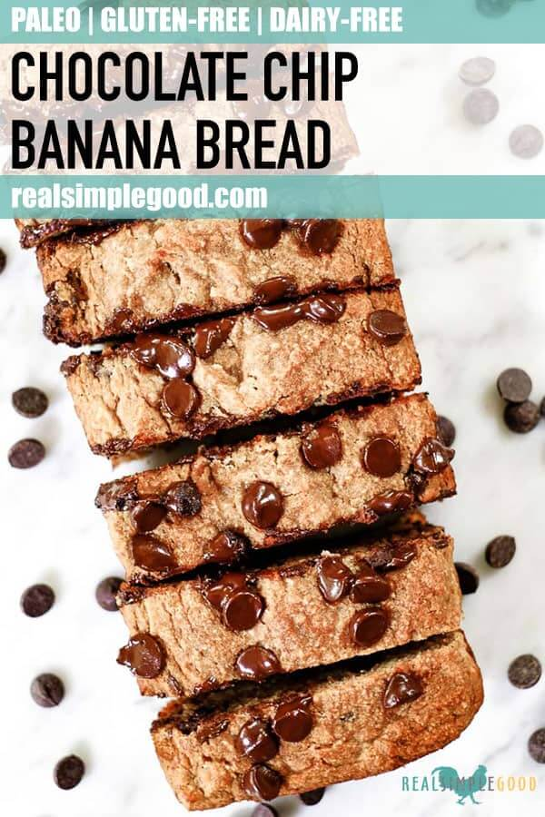 Paleo chocolate chip banana bread loaf sliced on table long pin.