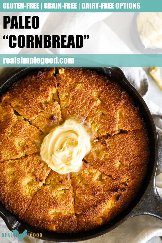 Close up image of paleo cornbread in a skillet with honey butter on top and text overlay at top.