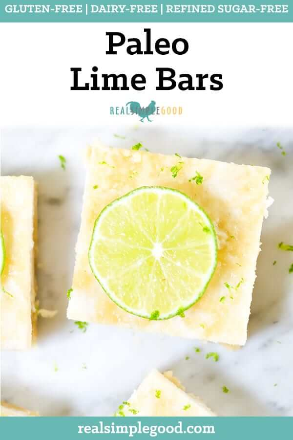 Paleo lime bars topped with lime zest and sliced lime long pin.