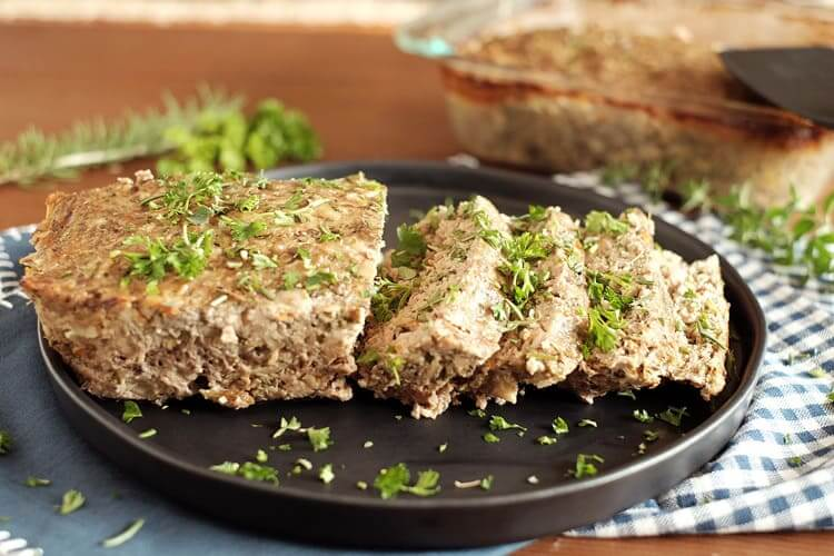 This paleo meatloaf has the flavor and seasonings of a normal meatloaf and it's packed with vegetables and fresh herbs. Comfort food that's good for you! Paleo, Gluten-Free and Whole30. | realsimplegood.com