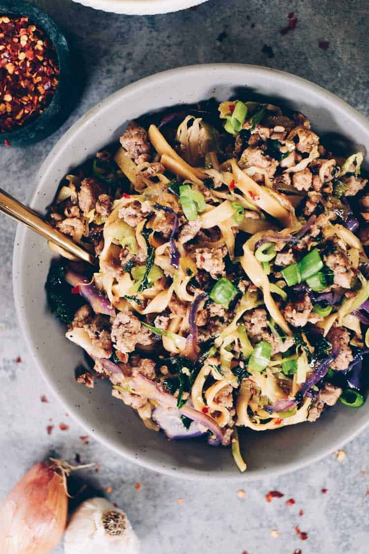 These Paleo potsticker noodle bowls are the BEST! Filled with cruciferous veggies, grain-free pasta and deliciously seasoned ground pork! Paleo, Gluten-Free, Dairy-Free + Soy-Free. | realsimplegood.com