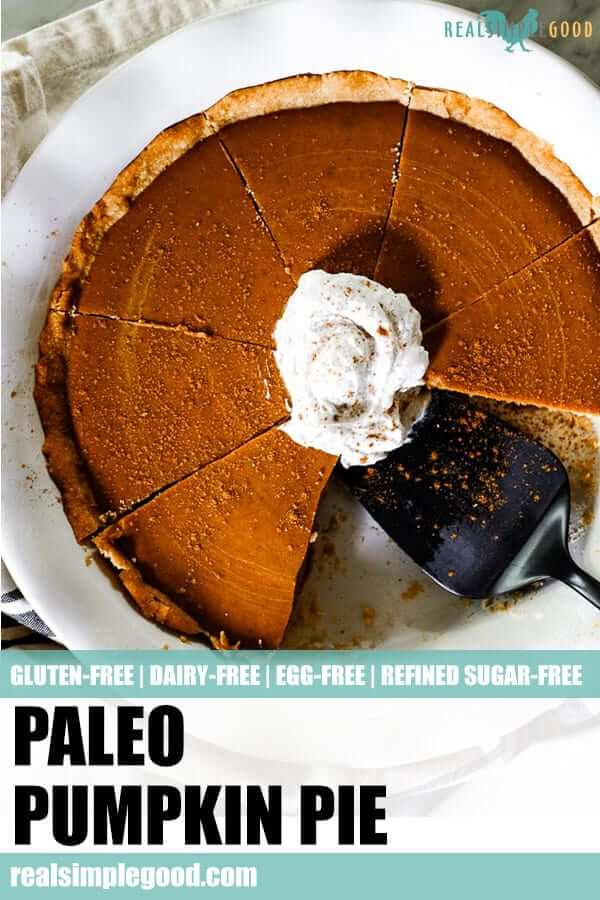 Paleo pumpkin pie in serving dish with coconut whipped cream and extra cinnamon on top long pin for pinterest.