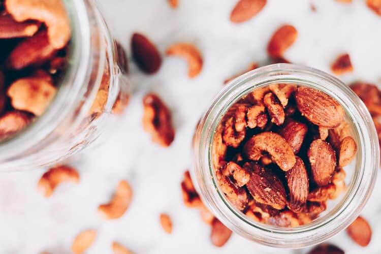 These Paleo spiced nuts are a great way to add extra flavor to your day! They are super simple and easy to make and obviously crazy addicting! Whole30 too! #paleo #whole30 #holidays #mixednuts #spicednuts | realsimplegood.com