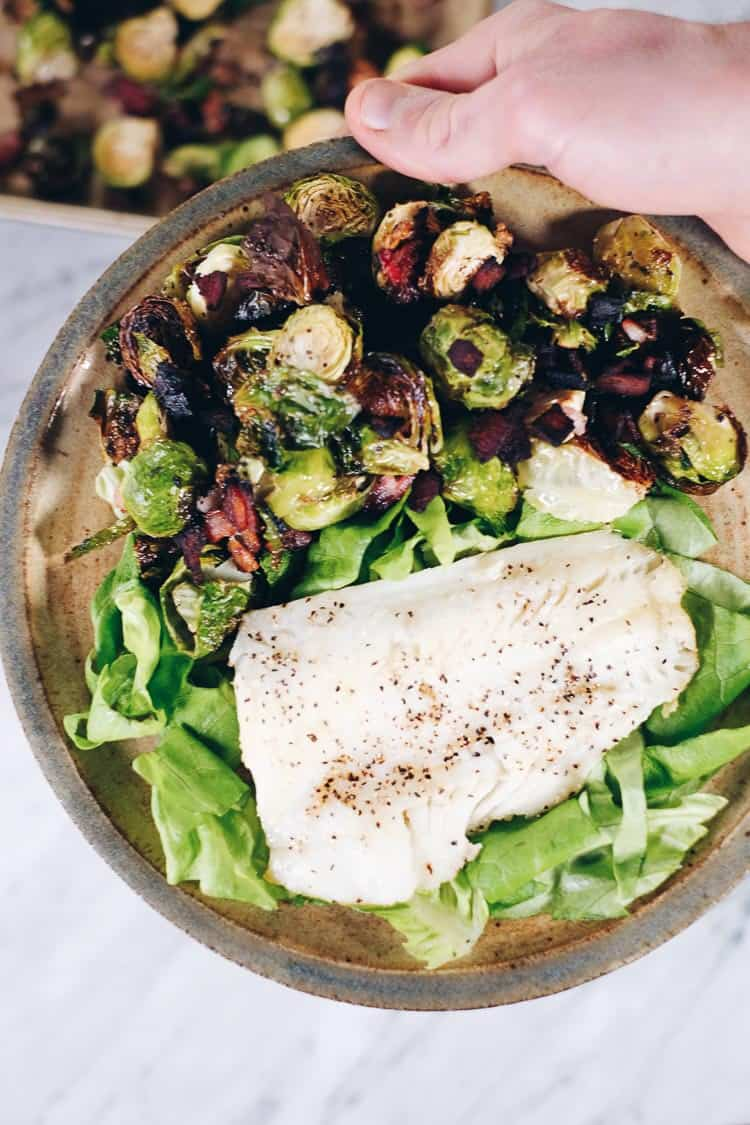 Originally, we wanted to add more fish to our lifestyle for the health benefits. Adding in recipes like this Pan Seared Cod with Garlicky Bacon Brussels Sprouts, we've been able to make healthy, satisfying meals that are ready in 30 minutes or less. #paleo #whole30 #healthyfats #fish | realsimplegood.com