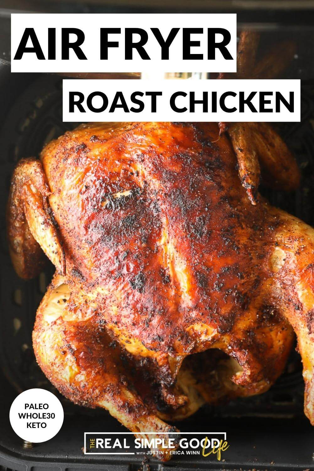 Close up image of roasted chicken in air fryer basket with text overlay on top