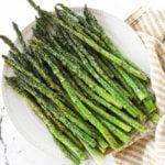 Air fryer asparagus served on a plate.