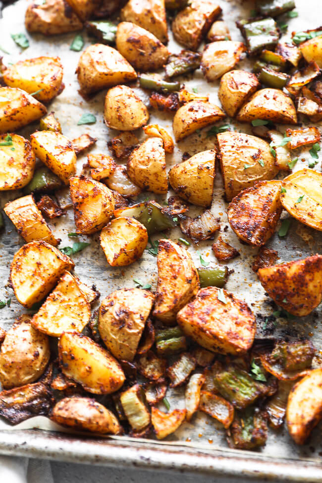 Roasted mexican potatoes on a sheet pan close up angle image