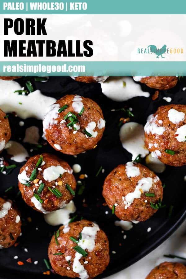Pork meatballs on a plate with ranch dressing, chopped chives, red pepper chili flakes and sesame seeds. Long pin for pinterest.