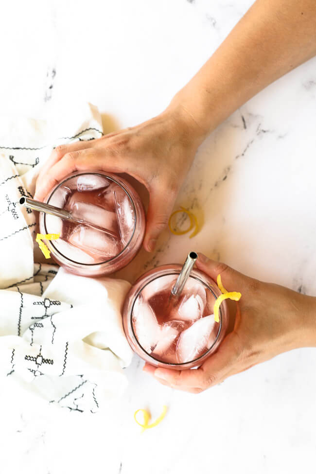 Overhead image of holding two glasses of this vodka lemonade cocktail.