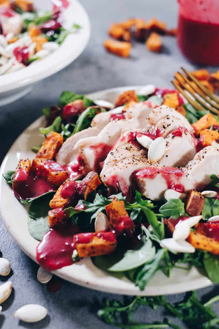 Looking for a new, festive dish to add to your holiday celebrations this year? Try this Paleo Roasted Sweet Potato Salad with Cranberry Vinaigrette! | realsimplegood.com