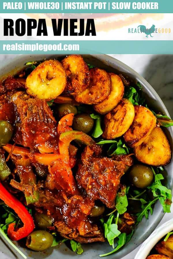 Close up shot of ropa vieja served in a bowl with greens and fried plantains. Long pin for pinterest.