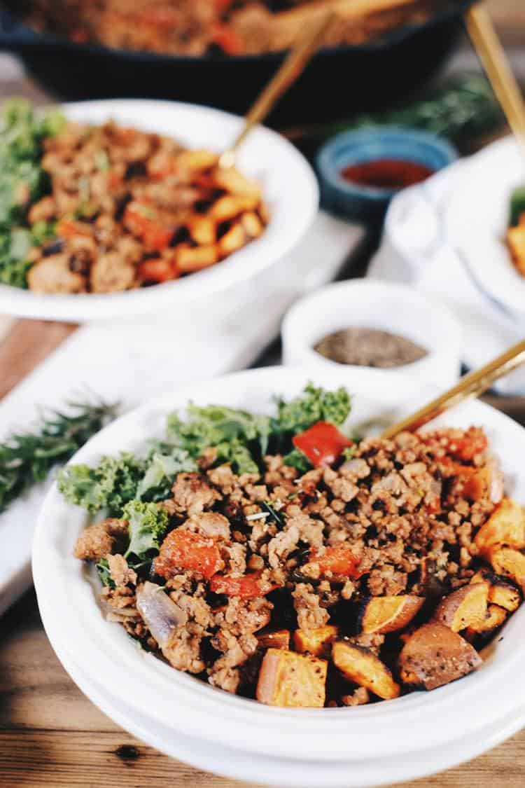 Make-ahead breakfasts are a life-saver during the work week for Whole30 + Paleo. This rosemary, sausage and sweet potato hash is perfect for re-heating! Paleo, Gluten-Free + Whole30. | realsimplegood.com