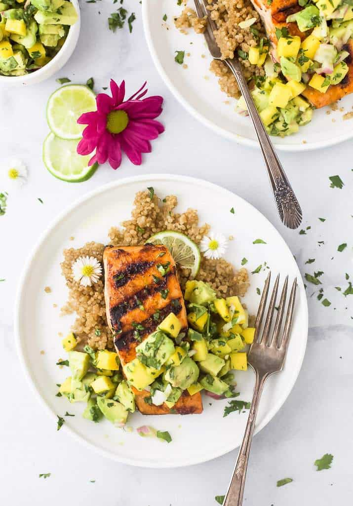 Grilled salmon with mango avocado salsa on a white plate