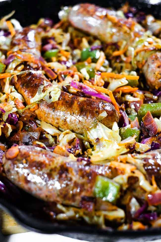 Close up angled shot of sausage and cabbage skillet.