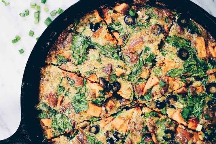 This Paleo + Whole30 sausage and sweet potato frittata is filling and full of the delicious flavors of sausage, sweet potatoes, olives and green onions. It will keep you going all morning! #paleo #whole30 #glutenfree #dairyfree #breakfast | realsimplegood.com