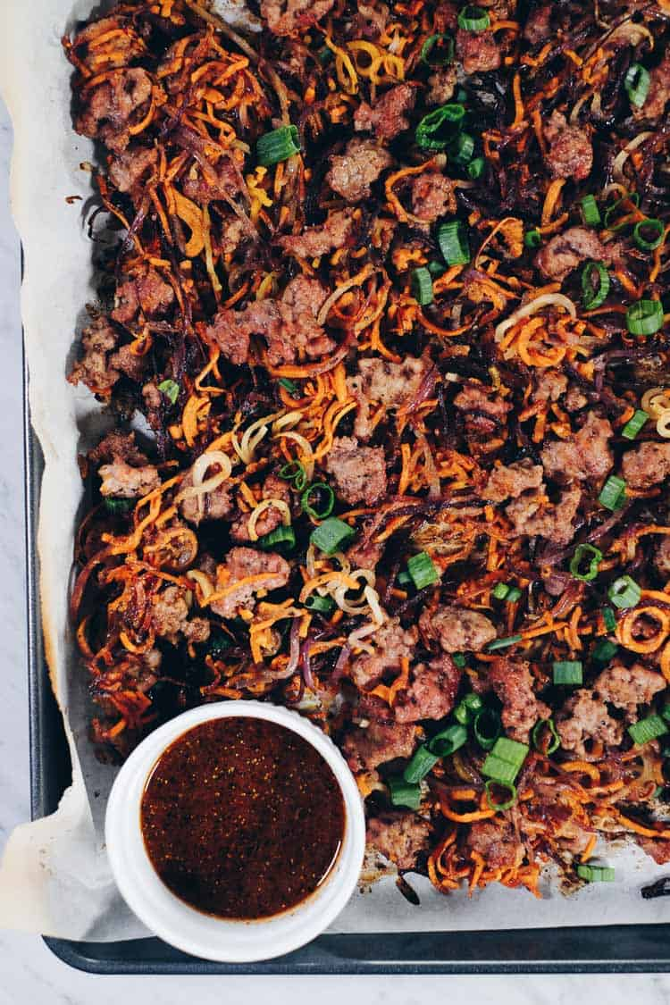 sheet pan with crumbled pork and spiralized cooked vegetables