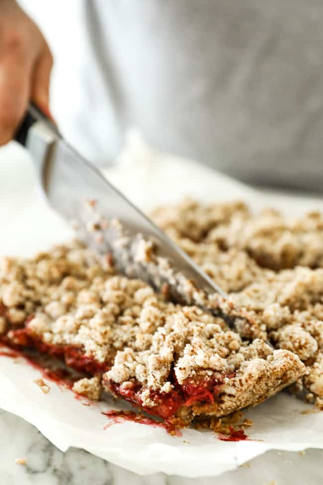 Image of cutting strawberry crumble bars.
