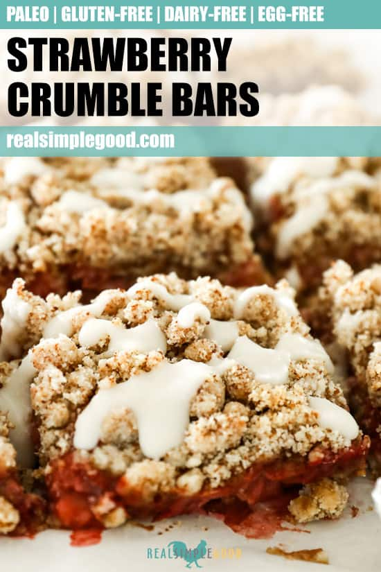 Close up image of strawberry crumble bars lined up on marble with text at the top for pinterest pin.