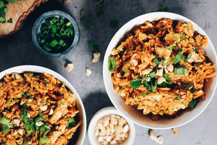 Sweet potato chicken pad thai in bowls horizontal image