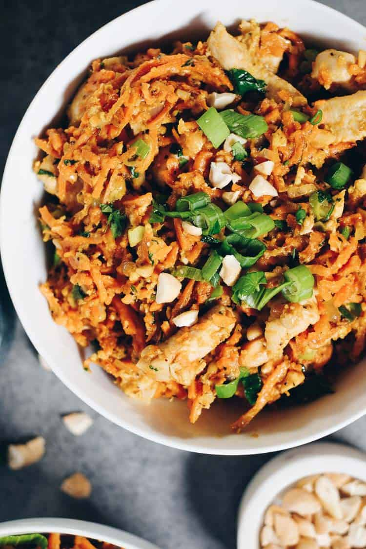 Sweet potato chicken pad thai with sliced green onions on top