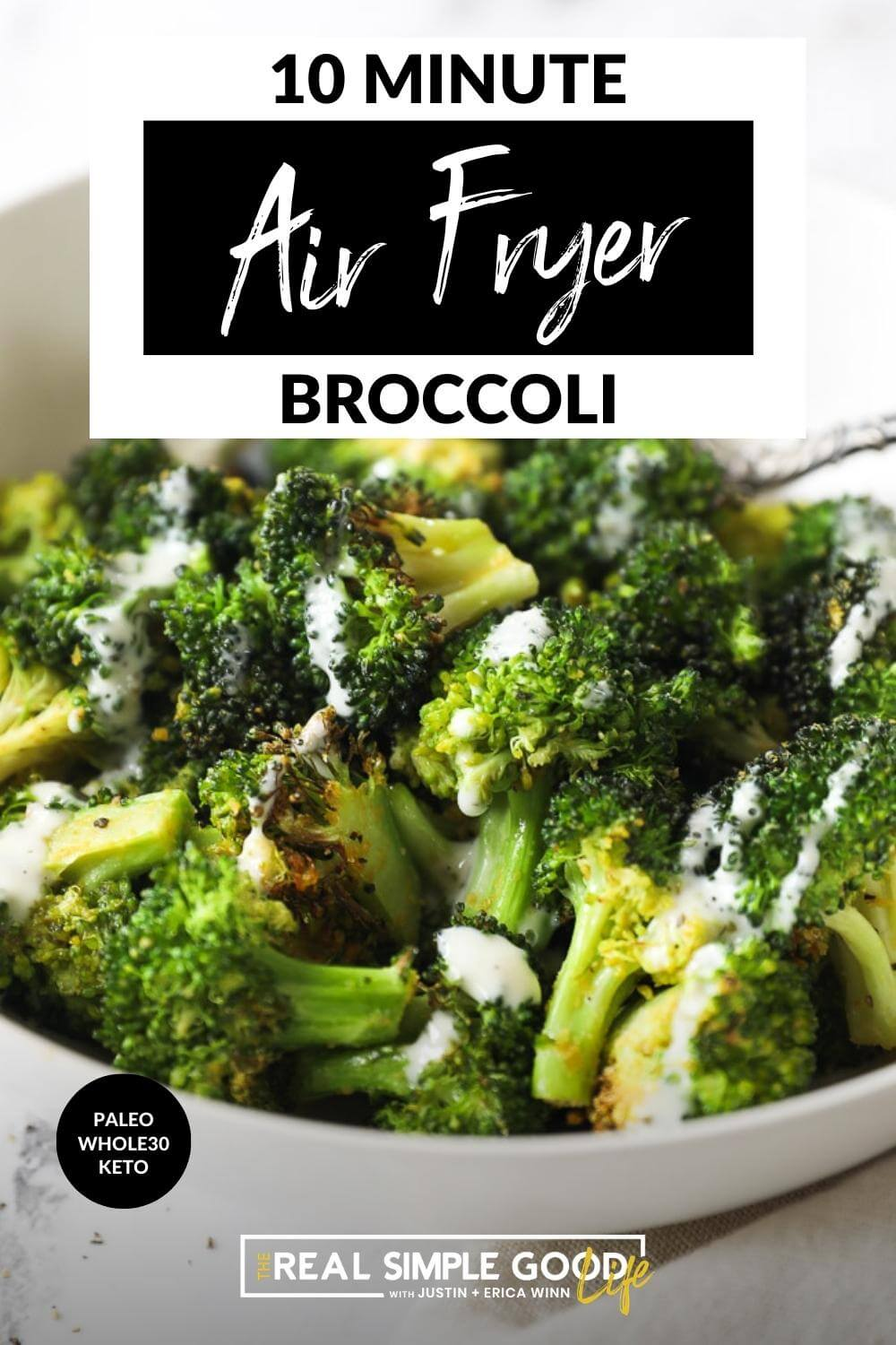 Close up angled image of air fryer broccoli with ranch drizzled on top and text overlay at top of image.