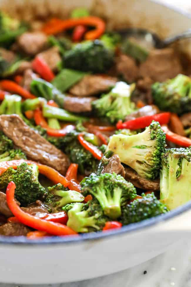 Close up of teriyaki beef recipe in pan with broccoli and peppers