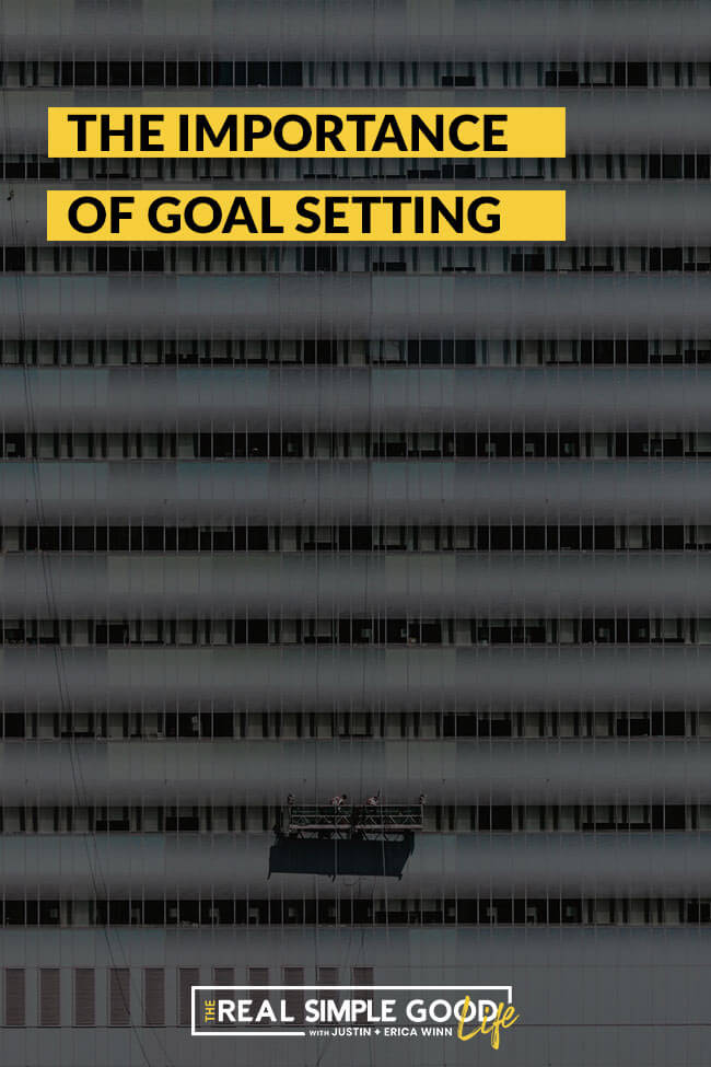 Image of window washers cleaning skyscraper with text overlay stating the importance of goal setting