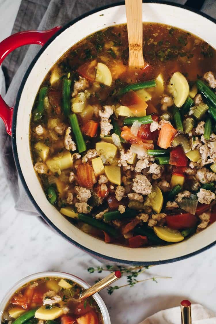 The abundance of summer produce inspired this Paleo and Whole30 turkey and summer vegetable soup. It's the perfect way to use up your garden fresh veggies!Filled with onion, celery, garlic, herbs, tomatoes and summer squash. Paleo + Whole30 | realsimplegood.com