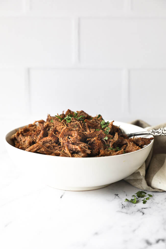Straight on shot of bowl of shredded instant pot beef