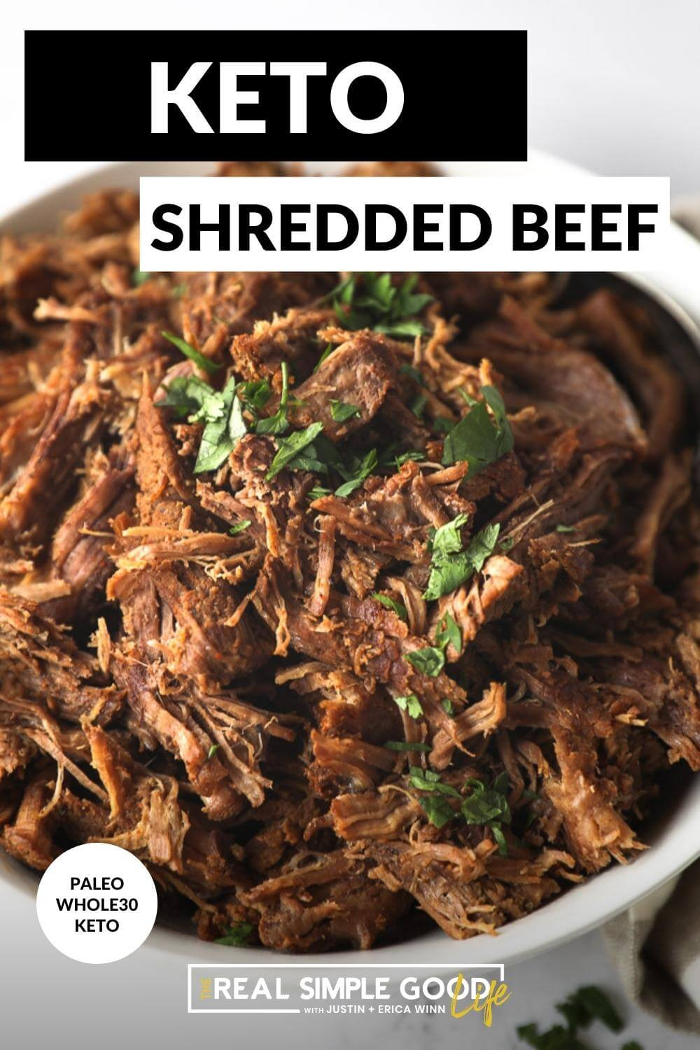 Close up image of shredded beef in a bowl with text overlay at top
