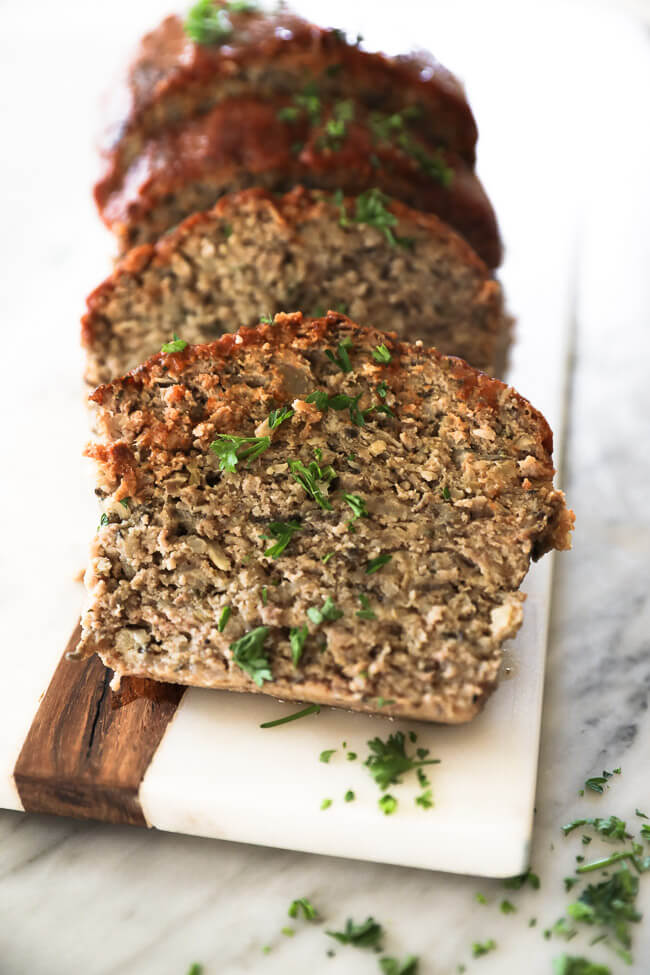 Slices of Whole30 Paleo Meatloaf on a board angle shot
