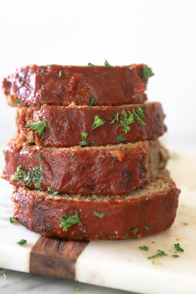 Slices of Whole30 Paleo Meatloaf stacked vertically
