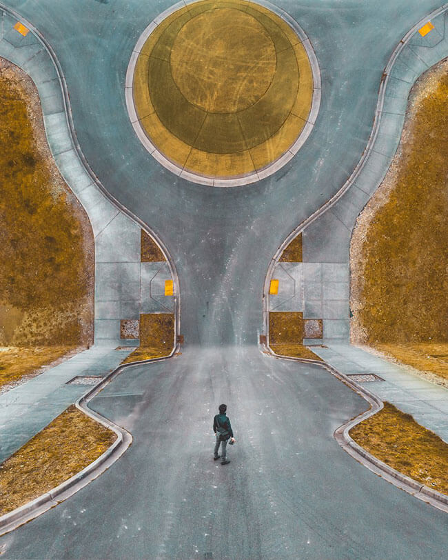 Man on road facing abstract image of road going vertical