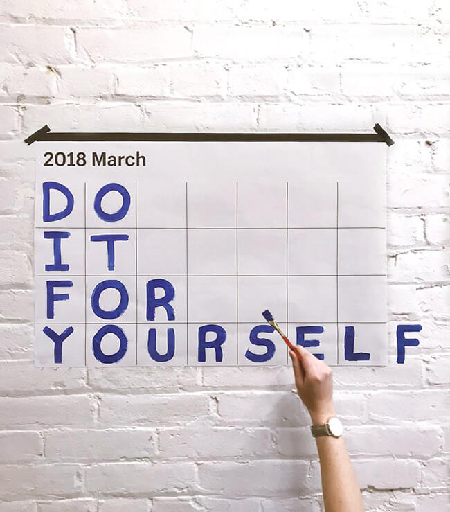 Motivation calendar hanging on wall stating do it for yourself