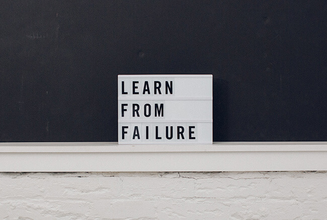 Sign that says learn from failure. Tips to overcome fear of failure.