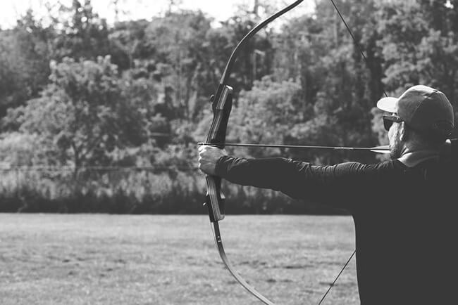 Archer with bow outside ready to shoot